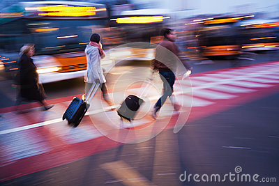 Traveling people at a bus station