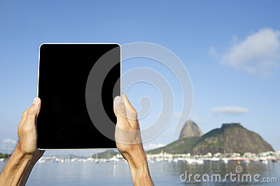 Traveling Tourist Using Tablet at Sugarloaf Rio de Janeiro Brazil