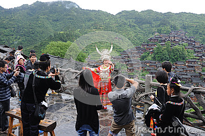Travellers take pictures in Chinese miao village Editorial Photography