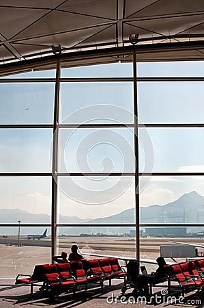 Travellers waiting at airport