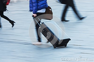 Travelling person with a trolley case