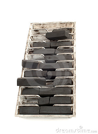 Tray of black drawing charcoal