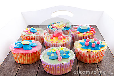 Tray with colorful decorated cupcakes