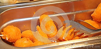 Tray filled with fried crab claws in a restaurant take away