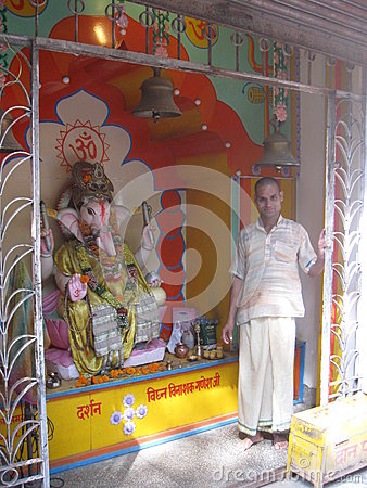 Trayabakeshwar Temple pujari offering blessings Ganesh Altar