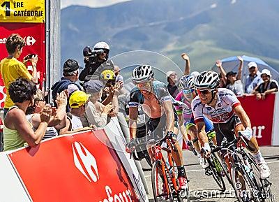 Tre cyklister Redaktionell Fotografering för Bildbyråer
