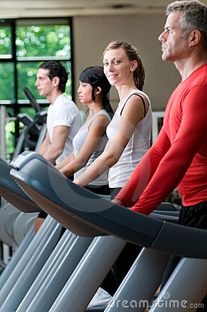 Treadmill exercises at gym