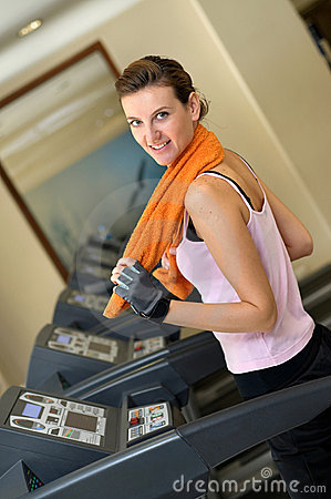 Treadmill Woman with Orange Towel