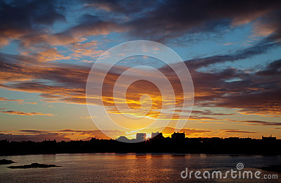 Trearddur bay Sunrise with the sun rising over Snowdonia Nationa