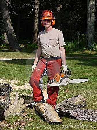 Tree felling: lumberjack man with chainsaw