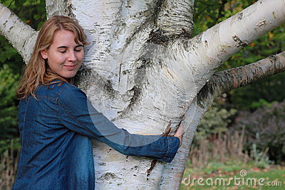 Woman hugging birch tree