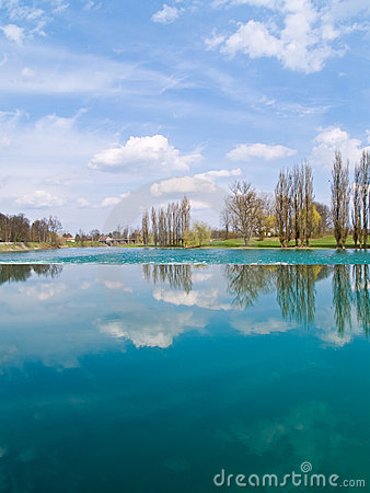 Free Trees And Clouds Reflecting On The River Royalty Free Stock Photography - 8261257
