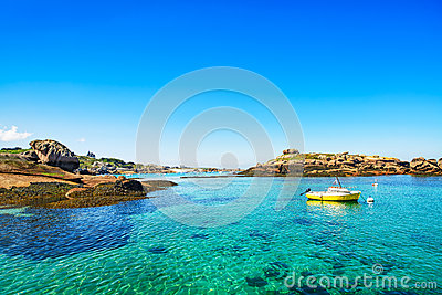 Tregastel, boat in fishing port. Pink granite coast, Brittany, France.