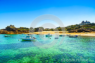 Tregastel, boats in beach bay. Pink granite coast, Brittany, Fra