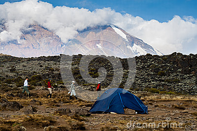 Trekkers walking near camp on Mount Kilimanjaro Editorial Image