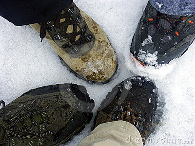 Trekking boots on snow floor