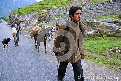 Trekking through hilly village Editorial Image