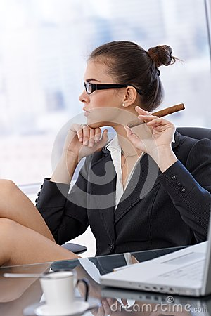 Trendy businesswoman with cigar