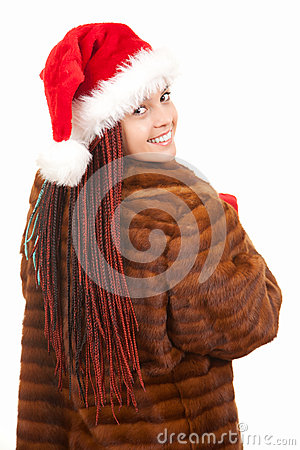 Trendy christmas girl with plait braids in fur coa