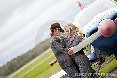 Trendy couple by private plane