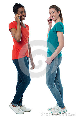 Trendy females speaking over cellphone