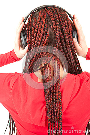 Trendy girl in ethnic hairstyle with headphones