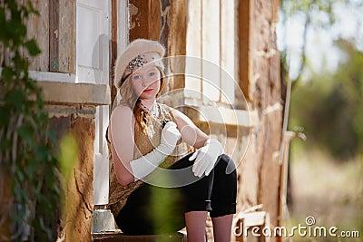 Trendy girl outside house