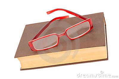 Trendy glasses on old book