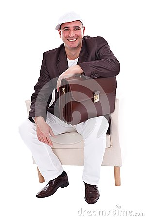 stock photo couple sitting together in an armchair credit