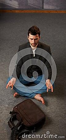 Trendy guy meditating