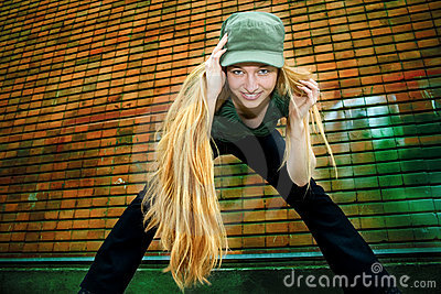 Trendy happy young woman with long blond hair