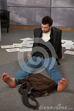 Trendy office worker on floor