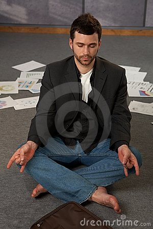 Trendy office worker meditating