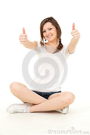 Trendy teenage girl with thumbs up