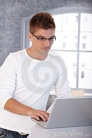 Free Trendy Young Man With Laptop Stock Image - 23993001