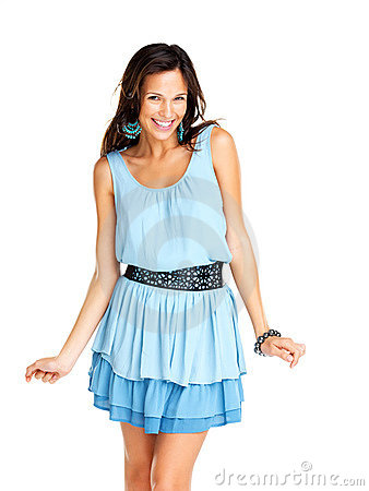 Trendy young woman in funky blue dress smiling