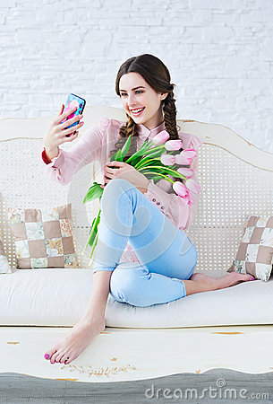 Free Trendy Young Woman Posing One Her Phone Camera Stock Images - 69028494