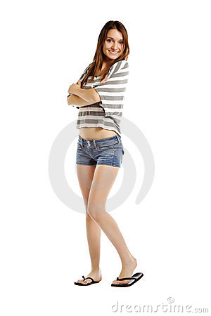 Trendy young woman smiling with arms crossed