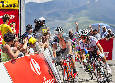 Tres ciclistas Imagen de archivo editorial