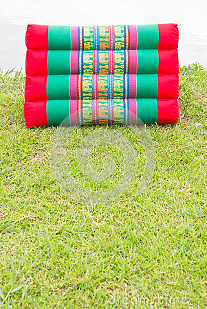 Free Triangle Colorful Pillows On The Grass. Royalty Free Stock Photography - 26150817