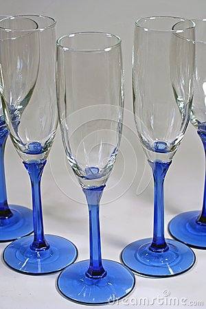 Triangle of shiny blue wine glasses