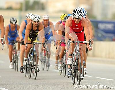 Triathletes on Bike event Editorial Stock Photo