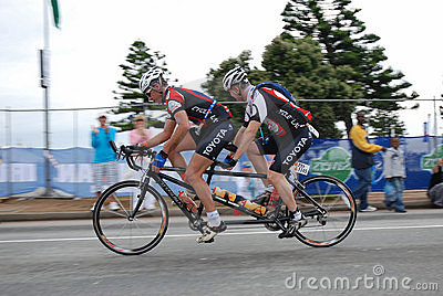 Triathletes on tandem bike Editorial Image