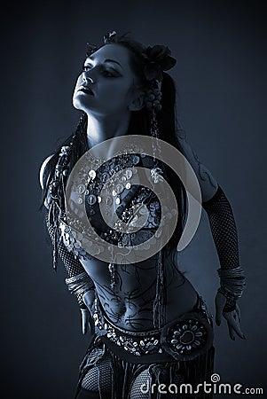 Tribal dancer in blue dark