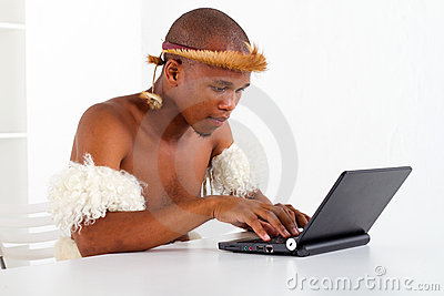 Tribal man learning computer