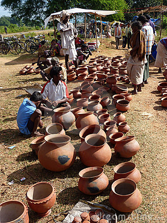 Tribal women buy clay pots Editorial Photo