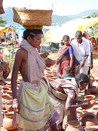 Tribal women buy clay pots Editorial Image