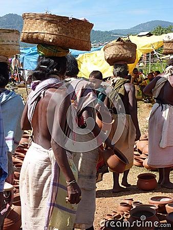 Tribal women buy clay pots Editorial Image