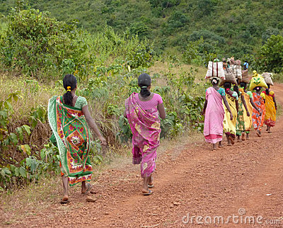 Tribal women carry goods Editorial Photography