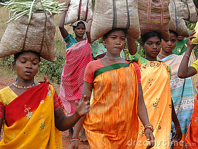 Tribal women carry goods  on their heads Editorial Photo